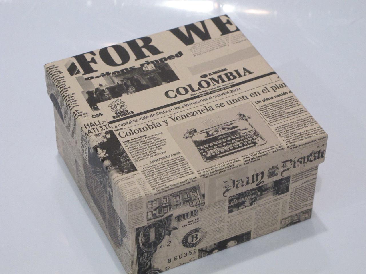 Упаковочная коробочка из бумаги или газеты